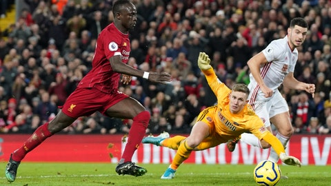 <p>               Liverpool's Sadio Mane, left, scores his side's second goal during the English Premier League soccer match between Liverpool and Sheffield United at Anfield Stadium, Liverpool, England, Thursday, Jan. 2, 2020. (AP Photo/Jon Super)             </p>