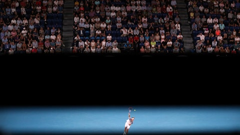 <p>               Austria's Dominic Thiem serves to Spain's Rafael Nadal during their quarterfinal match at the Australian Open tennis championship in Melbourne, Australia, Wednesday, Jan. 29, 2020. (AP Photo/Dita Alangkara)             </p>