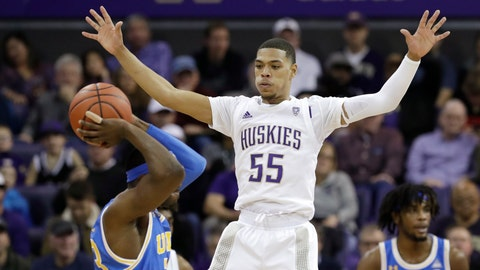 <p>               Washington's Quade Green (55) defends against UCLA's Prince Ali in the first half of an NCAA college basketball game Thursday, Jan. 2, 2020, in Seattle. (AP Photo/Elaine Thompson)             </p>