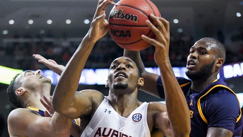<p>               Auburn center Austin Wiley (50) snags a rebound over Lipscomb guard Andrew Fleming (2) and center Ahsan Asadullah (23) during the second half of an NCAA college basketball game Sunday, Dec. 29, 2019, in Auburn, Ala. (AP Photo/Julie Bennett)             </p>