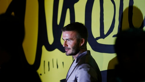 <p>               David Beckham poses for a photograph before a Christian Dior pre-fall 2020 men's fashion collection presentation during Art Basel on Tuesday, Dec. 3, 2019, in Miami. (AP Photo/Brynn Anderson)             </p>