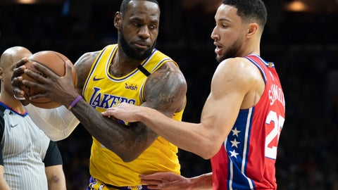 <p>               Los Angeles Lakers' LeBron James, left, tries to make his move on Philadelphia 76ers' Ben Simmons, right, during the first half of an NBA basketball game, Saturday, Jan. 25, 2020, in Philadelphia. (AP Photo/Chris Szagola)             </p>