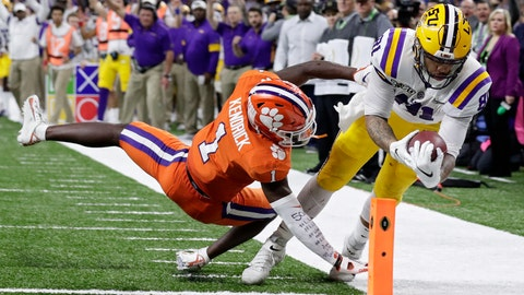 <p>               LSU tight end Thaddeus Moss scores a touchdown past Clemson cornerback Derion Kendrick during the second half of a NCAA College Football Playoff national championship game Monday, Jan. 13, 2020, in New Orleans. (AP Photo/Sue Ogrocki)             </p>