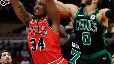 <p>               Chicago Bulls center Wendell Carter Jr., left, pulls in a rebound next to Boston Celtics forward Jayson Tatum (0) and guard Jaylen Brown (7) during the first half of an NBA basketball game in Chicago, Saturday, Jan. 4, 2020. (AP Photo/Nam Y. Huh)             </p>