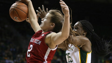 <p>               Texas Tech guard Sydney Goodson, left, grabs a rebound over Baylor center Queen Egbo, right, in the first half of an NCAA college basketball game, Saturday, Jan. 25, 2020, in Waco Texas. (AP Photo/Rod Aydelotte)             </p>