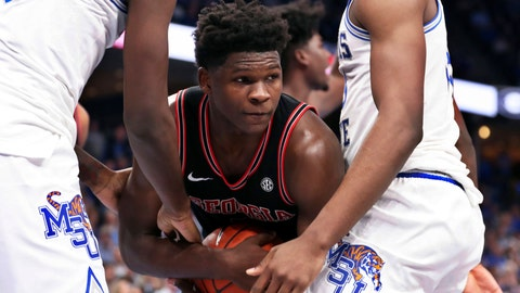 <p>               Georgia guard Anthony Edwards ( 5 ) grabs a rebound in the first half of an NCAA college basketball game against Memphis, Saturday, Jan. 4, 2020, in Memphis, Tenn. (AP Photo/Karen Pulfer Focht)             </p>