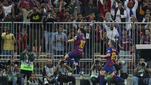 <p>               Barcelona's Lionel Messi, left, celebrates after scoring his side's opening goal during the Spanish Super Cup semifinal soccer match between Barcelona and Atletico Madrid at King Abdullah stadium in Jiddah, Saudi Arabia, Thursday, Jan. 9, 2020. (AP Photo/Hassan Ammar)             </p>