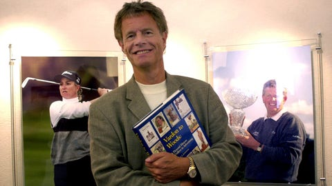 <p>               FILE - In this Aug. 21, 2003 file photo Alastair Johnston, vice chairman of IMG, poses outside his office with one of his books in Cleveland. Johnston has the largest collection of golf books in the world, and he' s gifting it to the R&A. (AP Photo/Jamie-Andrea Yanak, file)             </p>