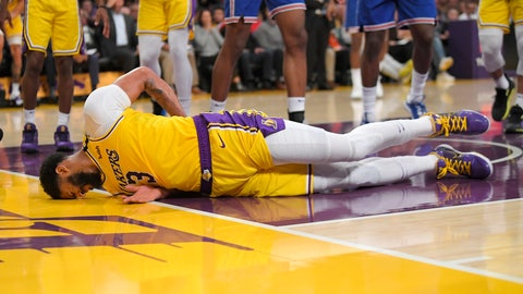 <p>               Los Angeles Lakers forward Anthony Davis winces as he hits the ground after falling while trying to defend against a shot by New York Knicks forward Julius Randle during the second half of an NBA basketball game Tuesday, Jan. 7, 2020, in Los Angeles. Davis left the game. The Lakers won 117-87. (AP Photo/Mark J. Terrill)             </p>