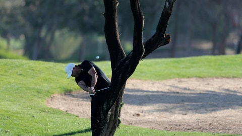<p>               Brooks Koepka from the U.S. plays a shot on the 16th hole during the first round one of the Abu Dhabi Championship golf tournament in Abu Dhabi, United Arab Emirates, Thursday, Jan. 16, 2020. (AP Photo/Kamran Jebreili)             </p>
