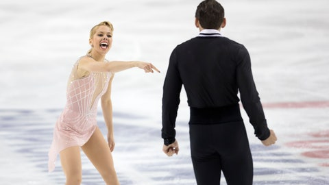 <p>               Alexa Knierim reacts pointing to Christopher Knierim at the completion of their program in the senior pairs at the U.S. Figure Skating Championships Thursday, Jan. 23, 2020 in Greensboro, N.C. They are in currently in first place after the program. (AP Photo/Lynn Hey)             </p>