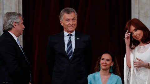 <p>               Outgoing president Mauricio Macri gestures before giving the presidential sash to new President Alberto Fernandez, left, at the Congress in Buenos Aires, Argentina, Tuesday, Dec. 10, 2019. At right is Vice President Cristina Fernandez de Kirchner. (AP Photo/Natacha Pisarenko)             </p>