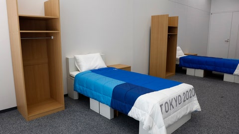 <p>               Two sets of bedroom furniture, including cardboard beds, for the Tokyo 2020 Olympic and Paralympic Villages are shown in a display room Thursday, Jan. 9, 2020, in Tokyo. Tokyo Olympic athletes beware - particularly larger ones. The single bed frames in the Athletes Village at this year's Olympics will be made of cardboard. The single bed frames will be recycled into paper products after the games. The mattress components - the mattress are not made of cardboard - will be recycled into plastic products.. (AP Photo/Jae C. Hong)             </p>