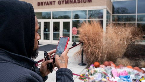 <p>               Michael Briggs of Philadelphia takes a photo at a small memorial left in remembrance to Kobe Bryant at the entrance of the Bryant Gymnasium at Lower Merion High School, Monday, Jan. 27, 2020, in Wynnewood, Pa.  The 41-year-old Bryant and his 13-year-old daughter, Gianna, were among nine people who died in the crash in Calabasas in foggy weather conditions Sunday morning. (AP Photo/Chris Szagola)             </p>