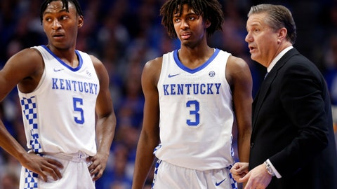 <p>               Kentucky's Immanuel Quickley (5) and Tyrese Maxey (3) and coach John Calipari confer during the second half of the team's NCAA college basketball game against Vanderbilt in Lexington, Ky., Wednesday, Jan 29, 2020. (AP Photo/James Crisp)             </p>
