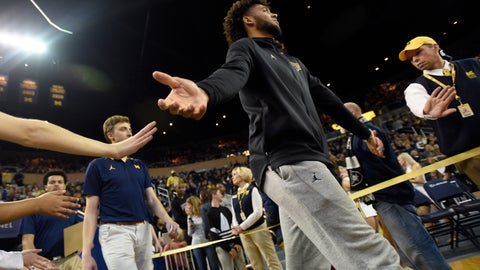 <p>               Michigan forward Isaiah Livers, who is injured and not playing, walks onto the court before an NCAA college basketball game against UMass-Lowell, Sunday, Dec. 29, 2019, in Ann Arbor, Mich. (AP Photo/Jose Juarez)             </p>