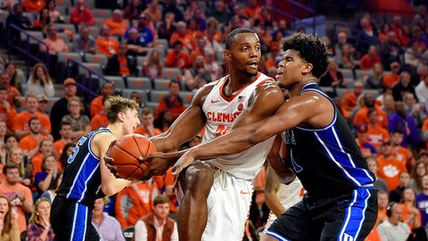 <p>               Clemson's Aamir Simms grabs a rebound while defended by Duke's Vernon Carey Jr. during the first half of an NCAA college basketball game Tuesday, Jan. 14, 2020, in Clemson, S.C. (AP Photo/Richard Shiro)             </p>