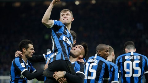 <p>               Inter Milan's Nicolo Barella, top, celebrates with his teammates after he scored his side's second goal during an Italian Cup quarter finals soccer match between Inter Milan and Fiorentina at the San Siro stadium, in Milan, Italy, Wednesday, Jan. 29, 2020. (AP Photo/Luca Bruno)             </p>
