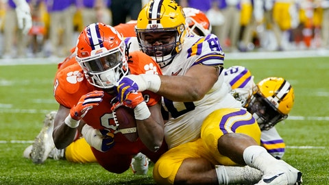 <p>               Clemson running back Travis Etienne scores past LSU defensive lineman Rashard Lawrence during the second half of a NCAA College Football Playoff national championship game Monday, Jan. 13, 2020, in New Orleans. (AP Photo/David J. Phillip)             </p>