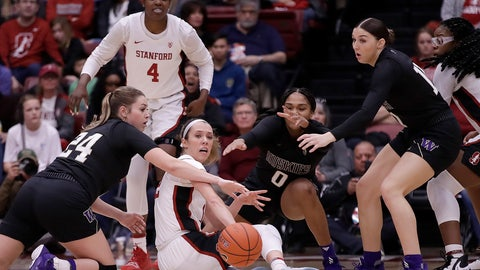 <p>               Stanford's Lexie Hull, center, passes the ball from the floor away from Washington's Ali Bamberger (24) during the first half of an NCAA college basketball game Sunday, Jan. 5, 2020, in Stanford, Calif. (AP Photo/Ben Margot)             </p>