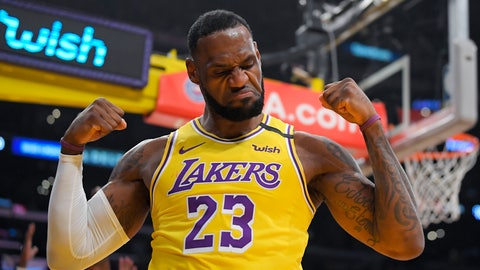 <p>               Los Angeles Lakers forward LeBron James gestures after scoring and drawing a foul during the first half of the team's NBA basketball game against the New York Knicks on Tuesday, Jan. 7, 2020, in Los Angeles. (AP Photo/Mark J. Terrill)             </p>