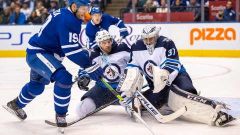 <p>               Toronto Maple Leafs center Jason Spezza (19) shoots on Winnipeg Jets goaltender Connor Hellebuyck (37) and defenseman Tucker Poolman (3) during the second period of an NHL hockey game, Wednesday, Jan. 8, 2020 in Toronto.(Frank Gunn/The Canadian Press via AP)             </p>