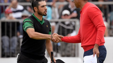 <p>               U.S. team player and captain Tiger Woods, right, shakes hands with International team player Abraham Ancer of Mexico after Woods won their singles match 3 and 2 during the President's Cup golf tournament at Royal Melbourne Golf Club in Melbourne, Sunday, Dec. 15, 2019. (AP Photo/Andy Brownbill)             </p>