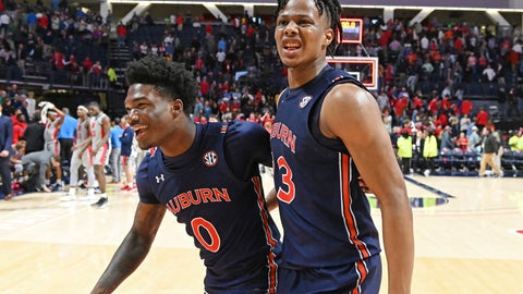 <p>               Auburn guard Tyrell Jones (0) and forward Isaac Okoro (23) react after the team's 83-82 double-overtime win over Mississippi in an NCAA college basketball game in Oxford, Miss., Tuesday, Jan. 28, 2020. (AP Photo/Thomas Graning)             </p>