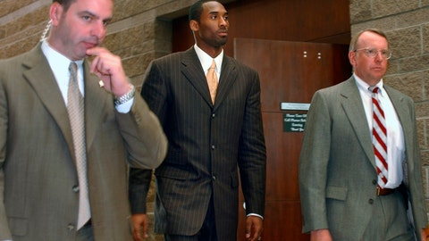 <p>               FILE - In this Wednesday, March 24, 2004, file photo, Los Angeles Lakers' Kobe Bryant, center, walks out of a holding area as he prepares to leave for a lunch break from proceedings in his sexual assault case as members of his security team accompany him, in Eagle, Colo. Some argued that there was no need to dredge up accounts of the 2003 rape allegation against Bryant when he died suddenly Sunday, Jan. 26, 2020. Others viewed it as another example of an icon being given a pass because he was a successful athlete. (AP Photo/Ed Andrieski, File)             </p>
