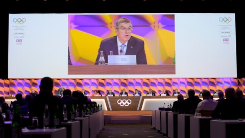 <p>               Thomas Bach, president of the International Olympic Committee (IOC), is seen on a video screen as he delivers a speech during the 135th Session of the IOC on the sideline of the the 3rd Winter Youth Olympic Games Lausanne 2020, at the SwissTech Convention Centre, in Lausanne, Switzerland, Friday, Jan. 10, 2020. (Laurent Gillieron/Keystone via AP)             </p>
