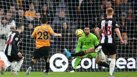 <p>               Newcastle United's Miguel Almiron scores during the English Premier League soccer match between Wolverhampton Wanderers and Newcastle United at Molineux, Wolverhampton, England, Saturday Jan. 11, 2020. (Nick Potts/PA via AP)             </p>