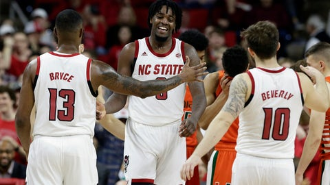 <p>               North Carolina State forward D.J. Funderburk, center, is congratulated by guard C.J. Bryce (13) and guard Braxton Beverly (10) during the second half of an NCAA college basketball game against Miami in Raleigh, N.C., Wednesday, Jan. 15, 2020. (AP Photo/Gerry Broome)             </p>