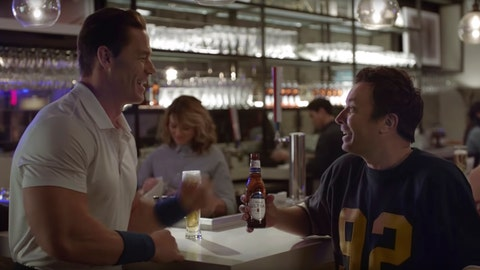 "<p>               This undated image provided by Michelob ULTRA shows John Cena, left, and Jimmy Fallon in a scene from the company's 2020 Super Bowl NFL football spot. Wrestler-turned-actor John Cena tries to convince Tonight Show host Jimmy Fallon that there's a ""lighter side"" to working out, with cameos by Tonight show band The Roots and runner Usain Bolt. (Michelob ULTRA via AP)             </p>"