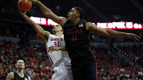 <p>               San Diego State's Matt Mitchell (11) goes for the block against UNLV's Marvin Coleman (31) during the first half of an NCAA college basketball game on Sunday, Dec. 26, 2020, in Las Vegas. (AP Photo/Joe Buglewicz)             </p>