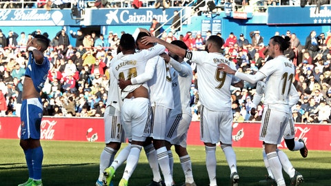 <p>               Real Madrid's Raphael Varane, third left, celebrates after scoring his side's opening goal during a Spanish La Liga soccer match between Getafe and Real Madrid at the Coliseum Alfonso Perez stadium in Getafe, Spain, Saturday, Jan. 4, 2020. (AP Photo/Paul White)             </p>