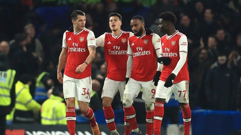 <p>               Arsenal's players celebrate a goal against Chelsea during the English Premier League soccer match between Chelsea and Arsenal at Stamford Bridge stadium in London England, Tuesday, Jan. 21, 2020. (AP Photo/Leila Coker)             </p>