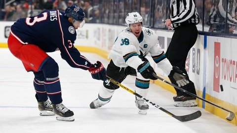 <p>               San Jose Sharks' Logan Couture, right, dumps the puck across the blue line past Columbus Blue Jackets' Seth Jones during the third period of an NHL hockey game, Saturday, Jan. 4, 2020, in Columbus, Ohio. The Sharks beat the Blue Jackets 3-2. (AP Photo/Jay LaPrete)             </p>