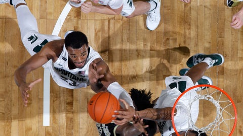 <p>               Michigan State's Xavier Tillman, left, and Marcus Bingham Jr., right, reach for a rebound with Western Michigan's Titus Wright, center, as Michigan State's Foster Loyer, top, watches, during the second half of an NCAA college basketball game, Sunday, Dec. 29, 2019, in East Lansing, Mich. Michigan State won 95-62. (AP Photo/Al Goldis)             </p>