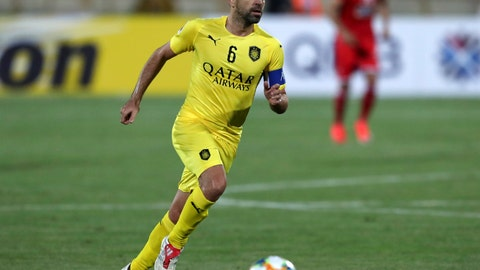 <p>               FILE - In this file photo dated Monday, May 20, 2019, Qatar's Al-Sadd player Xavi Hernandez, former Barcelona and Spain midfielder, controls the ball during an AFC Champions League match at the Azadi stadium in Tehran, Iran. Spain great Xavi Hernandez said Saturday Jan. 11, 2020, that for now he is committed to coaching his team in Qatar amid rumours that former club Barcelona has probed him about becoming its next coach. (AP Photo/Vahid Salemi, FILE)             </p>