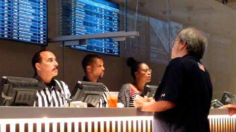 <p>               In this Sept. 5, 2019 photo, a gambler places sports bets at Bally's casino in Atlantic City, N.J. New Jersey gambling regulators have approved wagering on the XFL, becoming the sixth state to approve bets on the revived football league that last operated in 2001. Its season begins Feb. 8, 2020. (AP Photo/Wayne Parry)             </p>