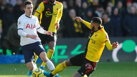 <p>               Tottenham's Giovani Lo Celso, left, is tailed by Watford's Etienne Capoue during the English Premier League soccer match between Watford and Tottenham Hotspur at Vicarage Road, Watford, England, Saturday, Jan. 18, 2020. (AP Photo/Frank Augstein)             </p>