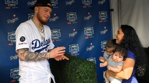 <p>               Los Angeles Dodgers' Alex Verdugo, left, gets ready to have his picture taken with Desirae Cortez, right, along with her children Emma, second from left, and Julianna during Dodger Stadium FanFest Saturday, Jan. 25, 2020, in Los Angeles. (AP Photo/Mark J. Terrill)             </p>
