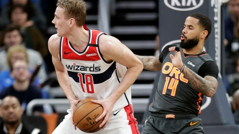 <p>               Washington Wizards center Anzejs Pasecniks (18) looks to pass the ball as he is defended by Orlando Magic guard D.J. Augustin (14) during the second half of an NBA basketball game Wednesday, Jan. 8, 2020, in Orlando, Fla. (AP Photo/John Raoux)             </p>
