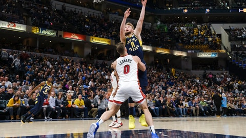 <p>               Indiana Pacers forward Domantas Sabonis (11) shoots over Miami Heat forward Meyers Leonard (0) during the second half of an NBA basketball game in Indianapolis, Wednesday, Jan. 8, 2020. The Heat won 122-108. (AP Photo/AJ Mast)             </p>
