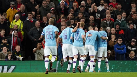 <p>               Manchester City's Bernardo Silva, right, is mobbed by his teammates after scoring the opening goal of the game during the English League Cup semifinal first leg soccer match between Manchester United and Manchester City and at Old Trafford, Manchester, England, Tuesday, Jan. 7, 2020. (AP Photo/Jon Super)             </p>
