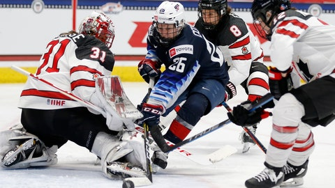 <p>               Canada's Geneviève Lacasse (31) blocks a shot by United States' Kendall Coyne Schofield (26) during the third period of a rivalry series women's hockey game in Hartford, Conn., Saturday, Dec. 14, 2019. (AP Photo/Michael Dwyer)             </p>