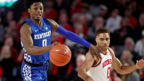 <p>               Kentucky guard Ashton Hagans (0) and Georgia guard Donnell Gresham Jr. (0) chase down a a loose ball in the first half of an NCAA college basketball game Tuesday, Jan. 7, 2020, in Athens, Ga. (AP Photo/John Bazemore)             </p>