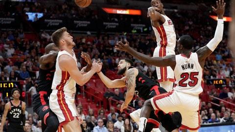 <p>               Toronto Raptors guard Fred VanVleet, center, drives to the basket as Miami Heat forward Meyers Leonard, left, center Bam Adebayo, center, and guard Kendrick Nunn (25) defend during the first half of an NBA basketball game, Thursday, Jan. 2, 2020, in Miami. (AP Photo/Lynne Sladky)             </p>