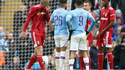 <p>               Fulham's Tim Ream, left, reacts after being shown a red card for a foul in the box during an English FA Cup fourth round soccer match between Manchester City and Fulham at the Etihad Stadium in Manchester, England, Sunday, Jan. 26, 2020. (AP Photo/Jon Super)             </p>