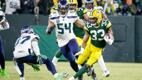 <p>               Green Bay Packers' Aaron Jones runs during the first half of an NFL divisional playoff football game against the Seattle Seahawks Sunday, Jan. 12, 2020, in Green Bay, Wis. (AP Photo/Mike Roemer)             </p>